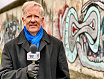 Correspondent Chas Henry at the Berlin Wall