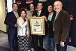 Los Angeles Mayor Eric Garcetti (center) presents KNX with a proclamation to celebrate 50 years of service to the city. Frank Mottek, Julie Chi, Ken Charles, Charles Feldman and Dick Helton accepted on behalf of all