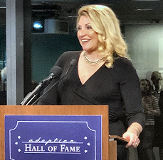 Delilah accepts the Adoption Hall of Fame Award