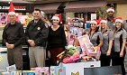 KNX-AM/Los Angeles: 1070 Newsradio brought its sixth annual ''CHiPs For Kids'' holiday toy drive and series profiling local communities, ''KNX On Your Corner,'' to Cerritos. Listeners were invited to a live broadcast at Mimi's Cafe and they generously dropped off a few hundred toys. L-R: KNX afternoon drive anchors Jim Thornton and Diane Thompson flank CHP Officer Jeremy Tolen, with employees of Walgreens who supported the toy drive and the KNX Street Team.