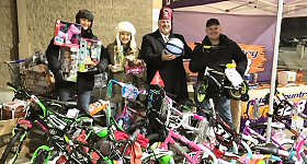 WIL-FM/St. Louis: for the third consecutive year, Bud and Broadway collected a record number of ''Bikes, Balls and Barbies'' 10,000 Toys for Girls and Boys. The New Country 92.3 Home Team collected more than 10,000 toys during the 36-hour weekend toy drive, benefitting the patients at Shriners Hospitals for Children St. Louis. Bud and Broadway and the New Country 92.3 Home Team collected toys over two days in order to bring joy (and toys) to kids at Shriners Hospitals for Children over Christmas.