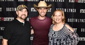 WJVL-FM/Janesville: WJVL Program Direcctor Justin Brown and his wife Mary visit with Dustin Lynch during on stop on the Very Hot Summer Tour in Chicago on September 14.