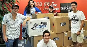 WSOU-FM/New York: The student-run radio station at Seton Hall University, set a new record for donations to its annual clothing drive for the Our Lady of the Sioux Church on the Pine Ridge Indian Reservation in South Dakota. The station collected enough clothing to fill 14 large boxes with clothes for all ages and all seasons. L-R: Sports Director Dalton Allison, Staff Rep Kaleigh Diamond, News Director Bob Towey, Technical Operations Director Jillian Fitzpatrick and Assistant News Director Ronald Castaneda.